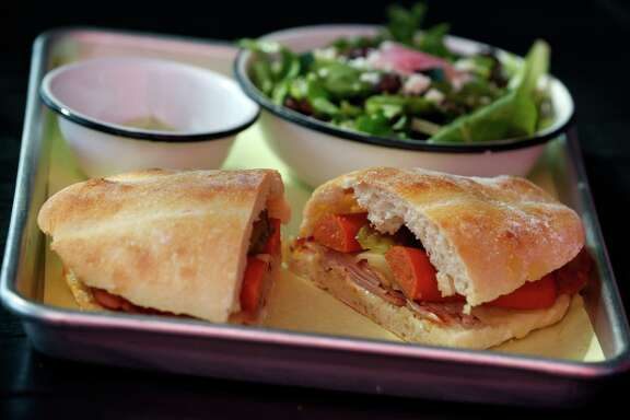 Diners choose a bread, a sandwich, such as a Cubana, and a side of soup or salad at La Panaderia on Broadway.