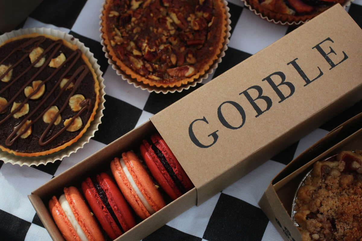 These are some of the products of Jeremy Mandrell and Anne Ng's Bakery Lorraine. In the box are macarons and on the right is their apple cranberry tart. On the bottom left is their chocolate hazelnut tart, on the center left and top is the pecan tart and top (mostly obscured) is the plum frangipane tart.