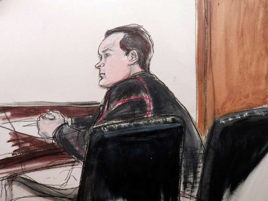 Yevgeny Buryakov appears in federal court in Manhattan Monday, Jan 26, 2015 in New York after his arrest earlier in the day in connection with a Cold War-style Russian spy ring that spoke in code, passed messages concealed in bags and magazines, and tried to recruit people with ties to an unnamed New York City university,  according to authorities.  At an initial court appearance, Assistant U.S. Attorney Adam Fee portrayed Buryakov as a professional spy skilled at duplicity who posed as an employee in the Manhattan branch of a Russian bank and lived in the Bronx with his Russian wife and two children. (AP Photo/Elizabeth Williams) ORG XMIT: NYR101 Photo: Elizabeth Williams / FRE 142054 AP