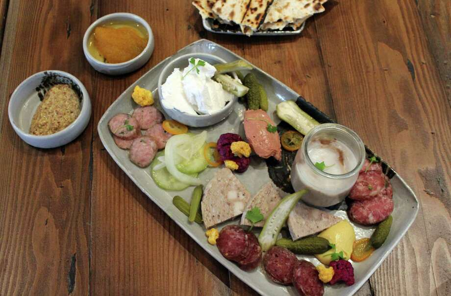 Cured features a daily selection of a dozen or so charcuterie options that are house-cured from 60 to 120 days. Guests can select three, six or nine items. Photo: Express-News File Photo / San Antonio Express-News