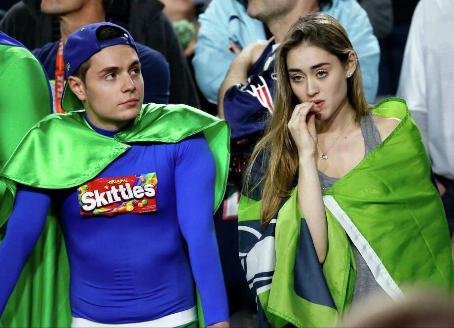 Seattle Seahawks fans react during the second half of the NFL Super Bowl XLIX football game between the Seahawks and the New England Patriots Sunday, Feb. 1, 2015, in Glendale, Ariz. The Patriots won 28-24. (AP Photo/Matt York)  ORG XMIT: NFL493 Photo: Matt York / AP
