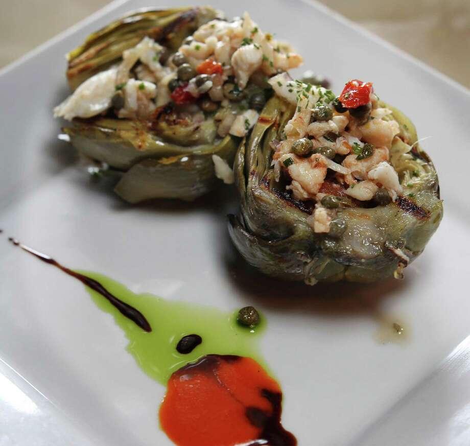Grilled artichoke with crab vinaigrette by Chef Damien Watel at Chez Vatel Bistro. Photo: Kin Man Hui /San Antonio Express-News / ©2013 San Antonio Express-News