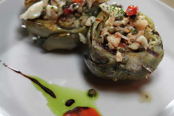 Grilled artichoke with crab vinaigrette by Chef Damien Watel at Chez Vatel Bistro.