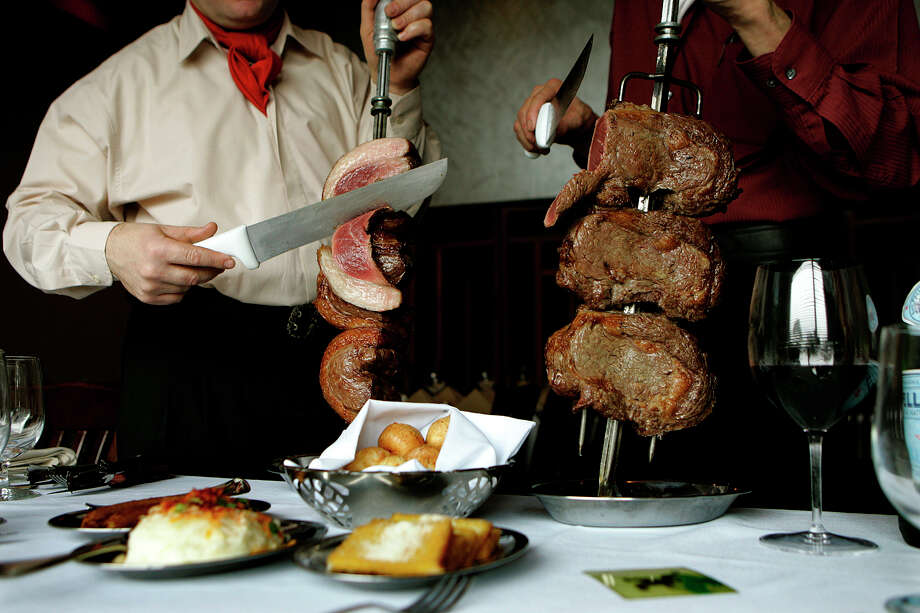 Chama Gaucha Brazilian Steakhouse has an all-you-can-eat steak menu including the Pieanha (left) and the rib-eye (right). Photo: Express-News File Photo / kgeil@express-news.net