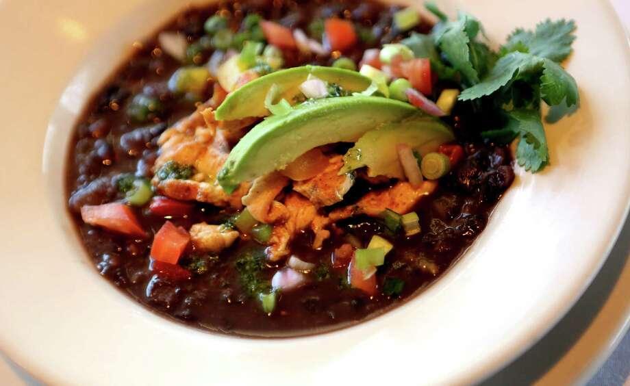 The Country-Style Black Bean Soup with Cilantro Pesto at Frederick's Bistro. Photo: Express-News File Photo / ©2013 San Antonio Express-News