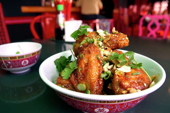 Twice fried chicken wings, topped with crab fat caramel, peanuts and cilantro