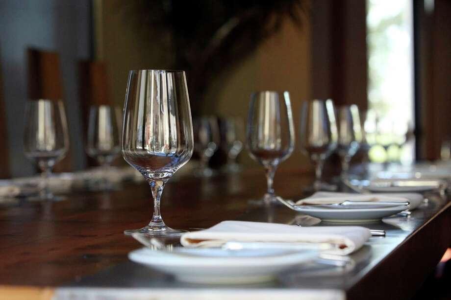 Communal table at Nao. Photo: Express-News File Photo / ©SAN ANTONIO EXPRESS-NEWS