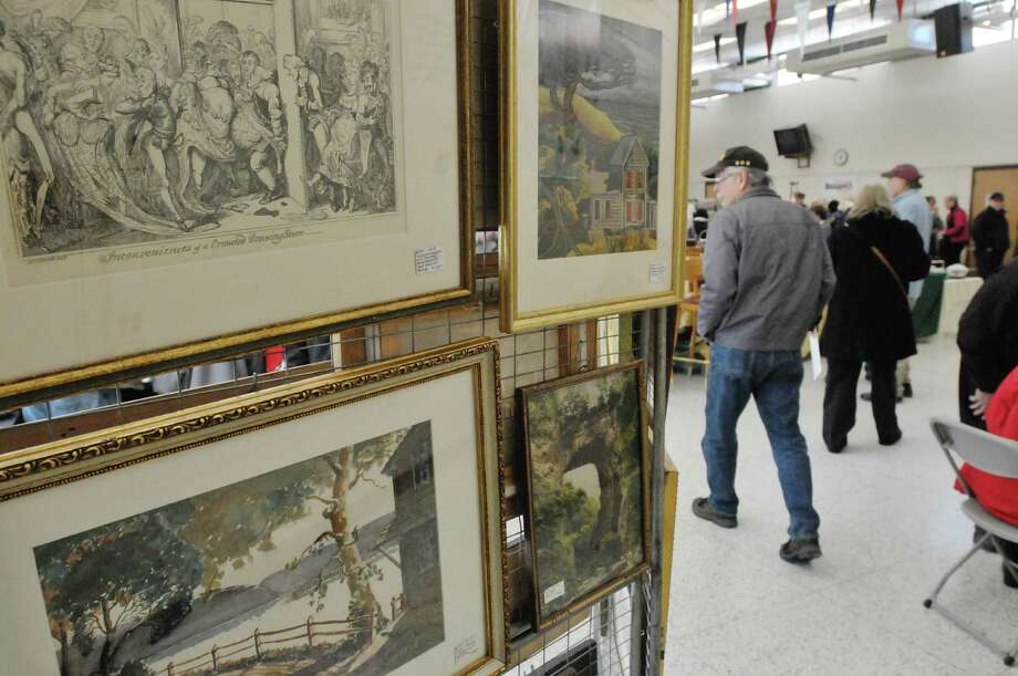 Artwork for sale is seen on display at the Southern Saratoga County Woman's Club's 39th Annual Antique Show and Sale on Sunday, Feb. 1, 2015, at Shenendehowa High School East in Clifton Park, N.Y.  The show is the organizations largest fund raising event of the year.  The money raised from the event funds  the Club's college scholarships and projects, focusing on early childhood literacy, food pantries, youth services and female veterans.   (Paul Buckowski / Times Union) Photo: Paul Buckowski / 00030417A