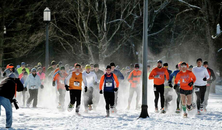 Racers head off from the start in the 5K snowshoe race at Saratoga Spa State Park during the Saratoga Winterfest on Sunday, Feb. 1, 2015, in Saratoga Springs, N.Y.  Winterfest events continue the rest of this week.  (Paul Buckowski / Times Union) Photo: Paul Buckowski / 00030396A