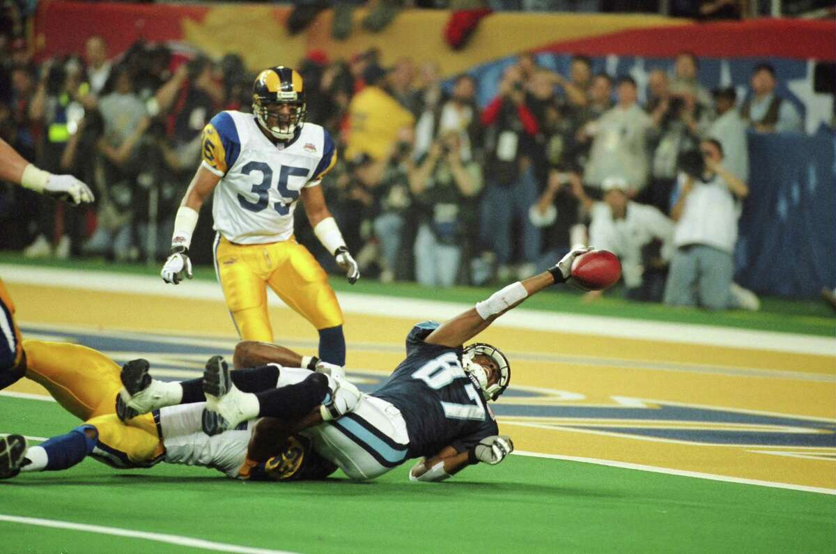 St. Louis LB Mike Jones tackles Tennessee WR Kevin Dyson just short of the goal line on the last play of the game during Super Bowl XXXIV at the Georgia Dome in Atlanta, GA on January 30, 2000. The Rams beat the Titans 23-16. (Photo by Mike Zarrilli/Getty Images)