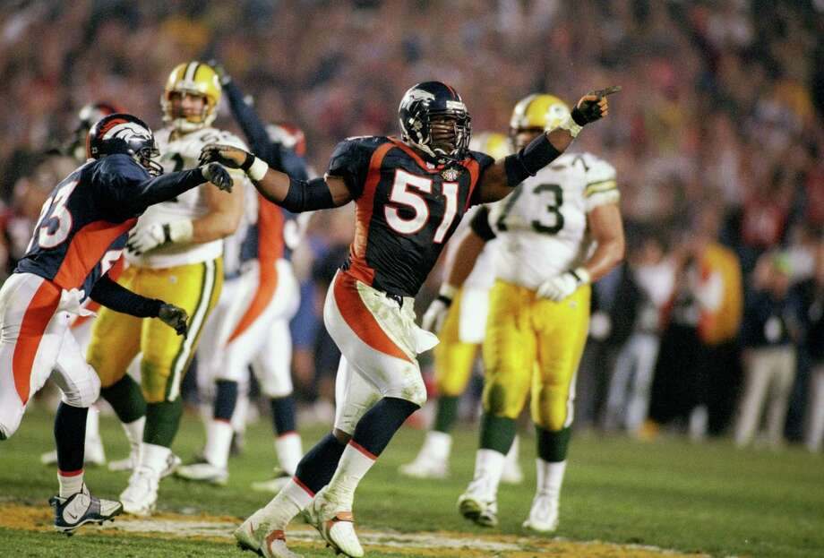 13. XXXII, 1998: Broncos 31, Packers 24In a back-and-forth game, the Broncos took a 31-24 lead on Terrell Davis' 1-yard touchdown run with 1:45 left after Green Bay coach Mike Holmgren opted to let Denver score. Brett Favre then drove the Packers into Denver territory, but John Mobley (51) knocked down Favre's fourth-down pass to Mark Chmura with less than 30 seconds left to give the Broncos and veteran QB John Elway their first Super Bowl championship. Photo: Al Bello, Chronicle Wire Services / Getty Images North America