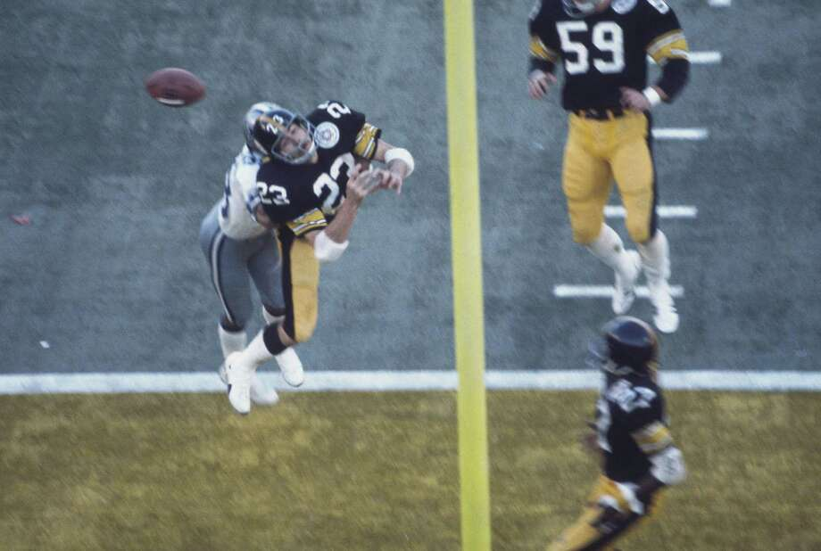 11. X, 1976: Steelers 21, Cowboys 17The Steelers trailed 10-7 entering the fourth quarter before rallying for 14 points. The Cowboys, trailing 21-17, got the ball back with 1:22 left, but Roger Staubach's Hail Mary was tipped by Mike Wagner (23) and intercepted in the end zone by Glen Edwards (27) as time expired. Photo: Focus On Sport, Chronicle Wire Services / 1976 Focus on Sport