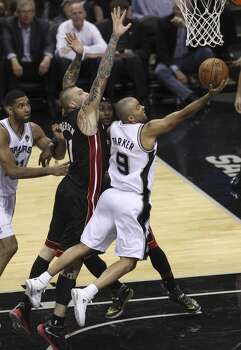San Antonio Spurs' Tony Parker drives on Miami Heat's Chris Andersen in Game 5 of the 2014 NBA Finals at the AT&T Center on Sunday, June 15, 2014. (Kin Man Hui/San Antonio Express-News) Photo: Kin Man Hui, San Antonio Express-News