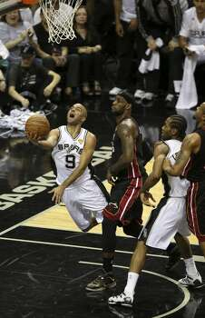 San Antonio Spurs' Tony Parker goes for the layup past Miami Heat's LeBron James during the first quarter of game five of the NBA Finals at the AT&T Center, Sunday, June 15, 2014. Photo: Jerry Lara, San Antonio Express-News
