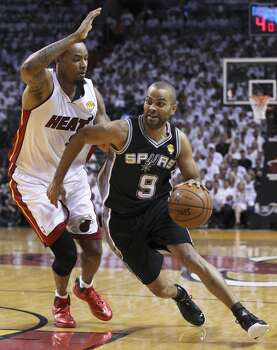 Miami Heat's Rashard Lewis (09) defends Spurs' Tony Parker (09) in the first half of Game 4 of the 2014 NBA Finals at the American Airlines Arena in Miami on Thursday, June 12, 2014. (Kin Man Hui/San Antonio Express-News) Photo: Kin Man Hui, San Antonio Express-News