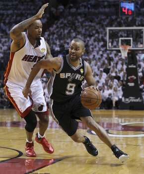 Spurs' Tony Parker (09) drives on Miami Heat's Rashard Lewis (09) in the first half of Game 4 of the 2014 NBA Finals at the American Airlines Arena in Miami on Thursday, June 12, 2014. (Kin Man Hui/San Antonio Express-News) Photo: Kin Man Hui, San Antonio Express-News