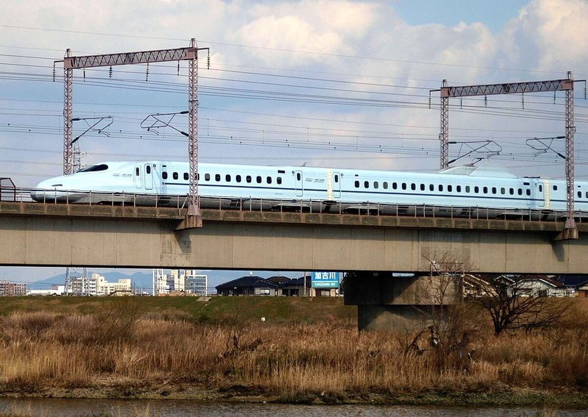 High-speed rail (such as Japan's Shinkansen bullet train, shown here) requires right-of-ways 50 to 80 feet wide, and in urban areas, a platform 20 feet tall. That's fine along a freeway. But it would devastate neighborhoods. (Photo: OpenCage.info, edited by Lisa Gray. CC BY-SA license.)