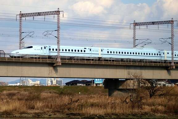 High-speed rail (such as Japan's Shinkansen bullet train, shown here) requires right-of-ways 50 to 80 feet wide, and in urban areas, a platform 20 feet tall. That's fine along a freeway. But it would devastate neighborhoods. (Photo: OpenCage.info, edited by Lisa Gray.  CC BY-SA license .)