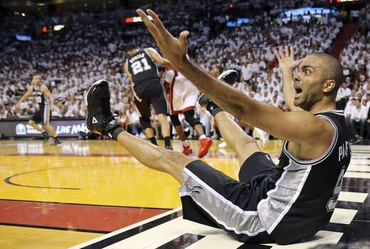 San Antonio Spurs' Tony Parker reacts after a play during Game 3 of the NBA Finals against the Miami Heat Tuesday June 10, 2014 at American Airlines Arena in Miami, Fla. Photo: Edward A. Ornelas, San Antonio Express-News
