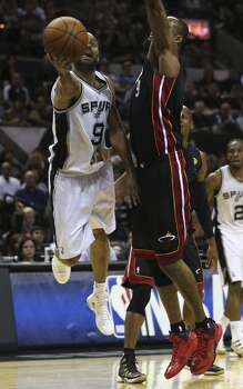 San Antonio Spurs' Tony Parker drives around Miami Heat's Rashard Lewis during the first half in game two of the NBA Finals at the AT&T Center, Sunday, June 8, 2014. Photo: Jerry Lara, San Antonio Express-News