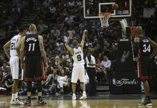 San Antonio Spurs' Tony Parker misses the free throws during the second half in game two of the NBA Finals against the Miami Heat at the AT&T Center, Sunday, June 8, 2014. The Heat won 98-96 to tie the series at 1-1. Photo: Jerry Lara, San Antonio Express-News