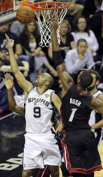 San Antonio Spurs' Tony Parker shoots around Miami Heat's Chris Bosh during first half action in Game 2 of the NBA Finals Sunday June 8, 2014 at the AT&T Center. Photo: Edward A. Ornelas, San Antonio Express-News
