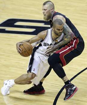 San Antonio Spurs' Tony Parker looks for room around Miami Heat's Chris Andersen during first half action in Game 2 of the NBA Finals Sunday June 8, 2014 at the AT&T Center. Photo: Edward A. Ornelas, San Antonio Express-News