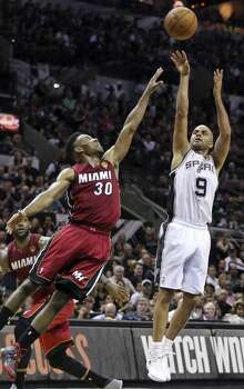 San Antonio Spurs' Tony Parker shoots over Miami Heat's Norris Cole during first half action in Game 1 of the NBA Finals Thursday June 5, 2014 at the AT&T Center. Photo: Edward A. Ornelas, San Antonio Express-News