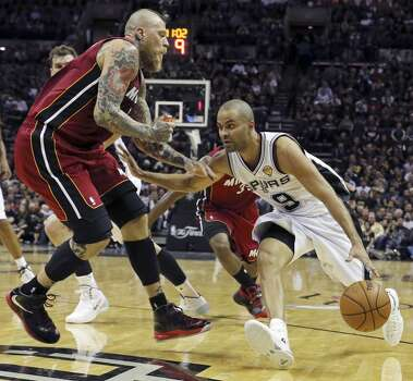 San Antonio Spurs' Tony Parker looks for room around Miami Heat's Chris Andersen during first half action in Game 1 of the NBA Finals Thursday June 5, 2014 at the AT&T Center. Photo: Edward A. Ornelas, San Antonio Express-News