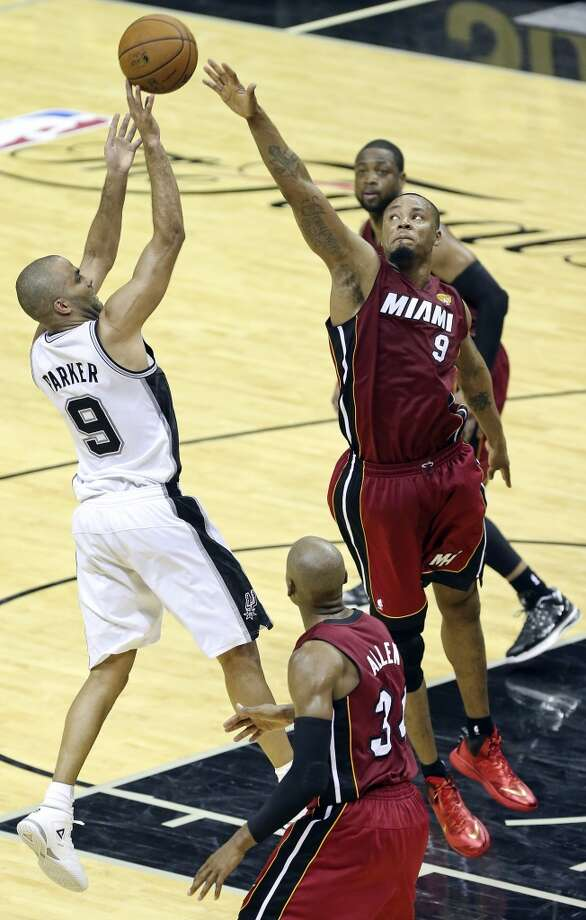 San Antonio Spurs' Tony Parker shoots over Miami Heat's Rashard Lewis as Miami Heat's Ray Allen (bottom) and Dwyane Wade look on during second half action in Game 1 of the NBA Finals Thursday June 5, 2014 at the AT&T Center. The Spurs won 110-95. Photo: Edward A. Ornelas, San Antonio Express-News