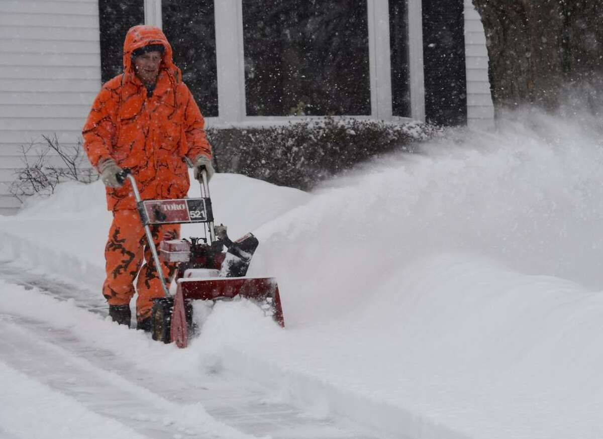 Nick DiLello stands out from the snow as he clears it on Monday, Feb. 2, 2015. (Skip Dickstein / Times Union)