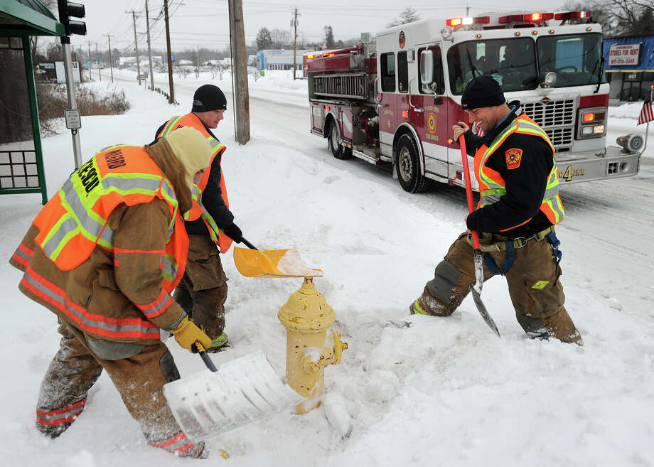 A Milford fire crew works its way up and down the Post Road clearing snow from around fire hydrants in the aftermath of the storm in Milford, Conn. on Monday, February 2, 2015. Photo: Brian A. Pounds / Connecticut Post
