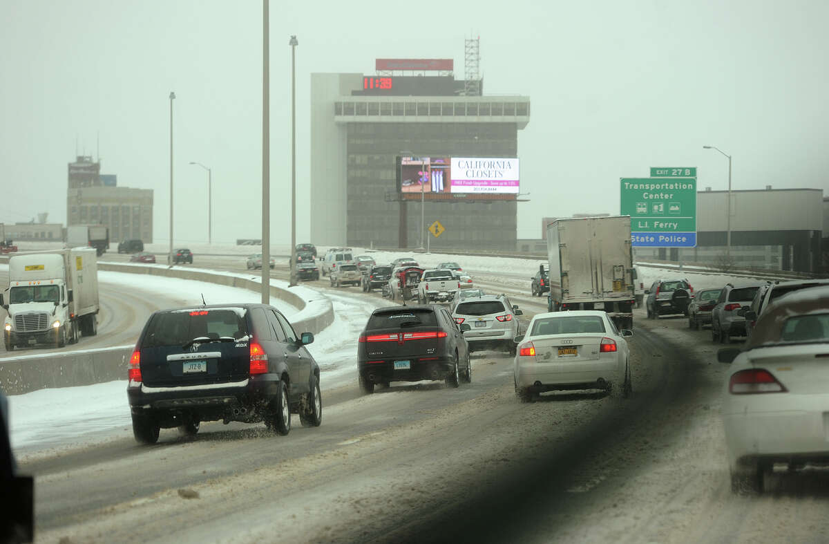Traffic crawls along I-95 in Bridgeport, Conn. during the snowstorm on Monday, February 2, 2015.