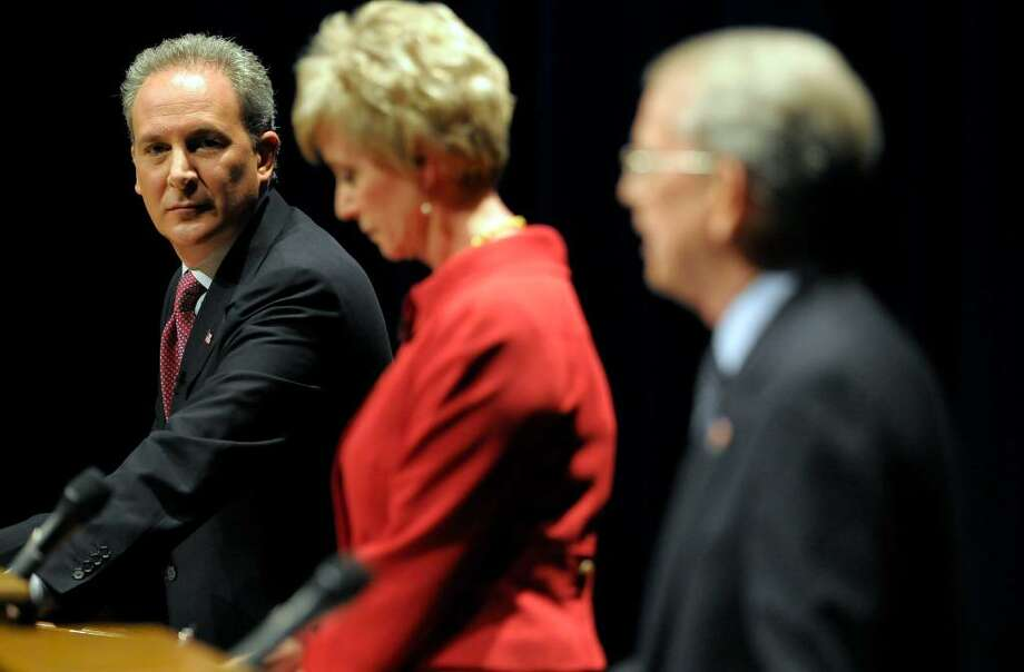 From left, Republican hopefuls for U.S. Senate, money manager Peter Schiff, former World Wrestling Entertainment CEO Linda McMahon and Former Congressman Rob Simmons, debate at the Lincoln Theater on the University of Hartford campus in West Hartford, Conn., Tuesday, March 2, 2010.  (AP Photo/John Woike, Pool) Photo: John Woike, AP / Pool, The Hartford Courant