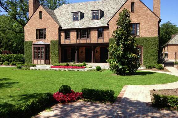 The new brick walk was placed to the side to create an unbroken expanse of lawn for a game of croquet.