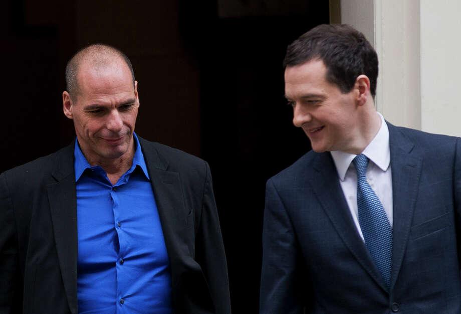 Britain's George Osborne (right) bids farewell to Greece's Yanis Varoufakis after their meeting. Photo: Matt Dunham / Associated Press / AP