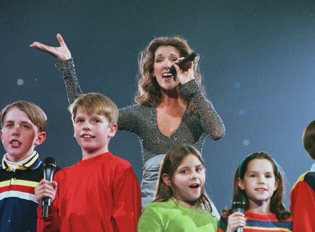 Celine Dion is joined by area youths ages 10 -12 from the Young actors Guild as she performs Tuesday night, Dec. 1, 1998, at the Pepsi Arena in Albany. (Will Waldron/Times Union) Photo: Will WALDRON / Albany Times Union