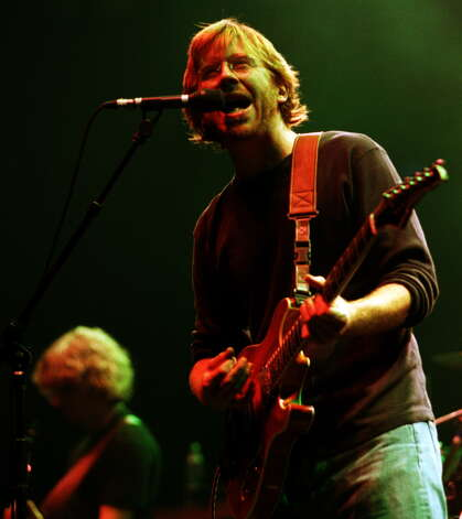 Phish front man Trey Anastasio bursts into song for the first night of a 2 day performance at the Pepsi, Albany, Friday September 8, 2000.  (Will Waldron/Times Union) Photo: WILL WALDRON / ALBANY TIMES UNION