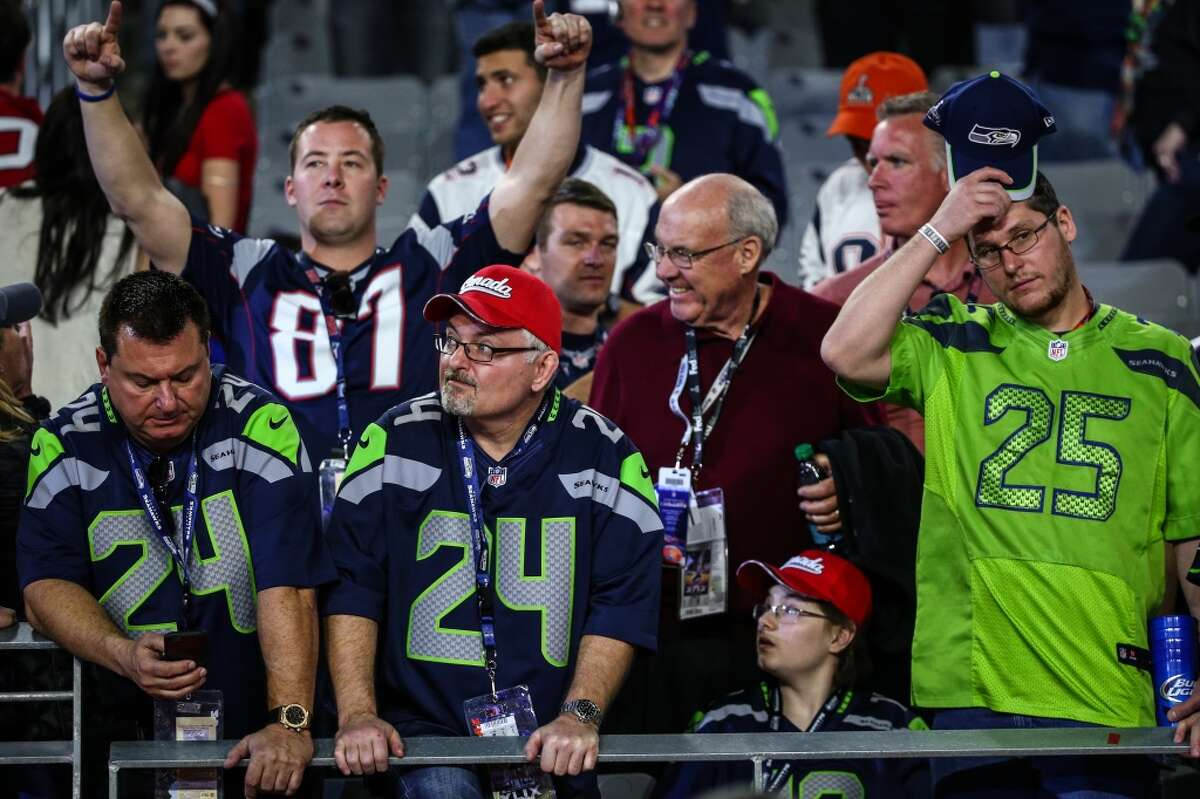 Seahawks fans react to the end of the game against the New England Patriots during Super Bowl XLIX at University of Phoenix Stadium. The Seahawks lost to the Patriots 28 to 24. Photographed on Sunday, February 1, 2015. (Joshua Trujillo, seattlepi.com)