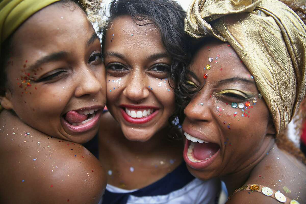 GLITTER GALS: Revelers party cheek to cheek at a bloco street parade during pre-Carnival festivities in Rio de Janeiro.
