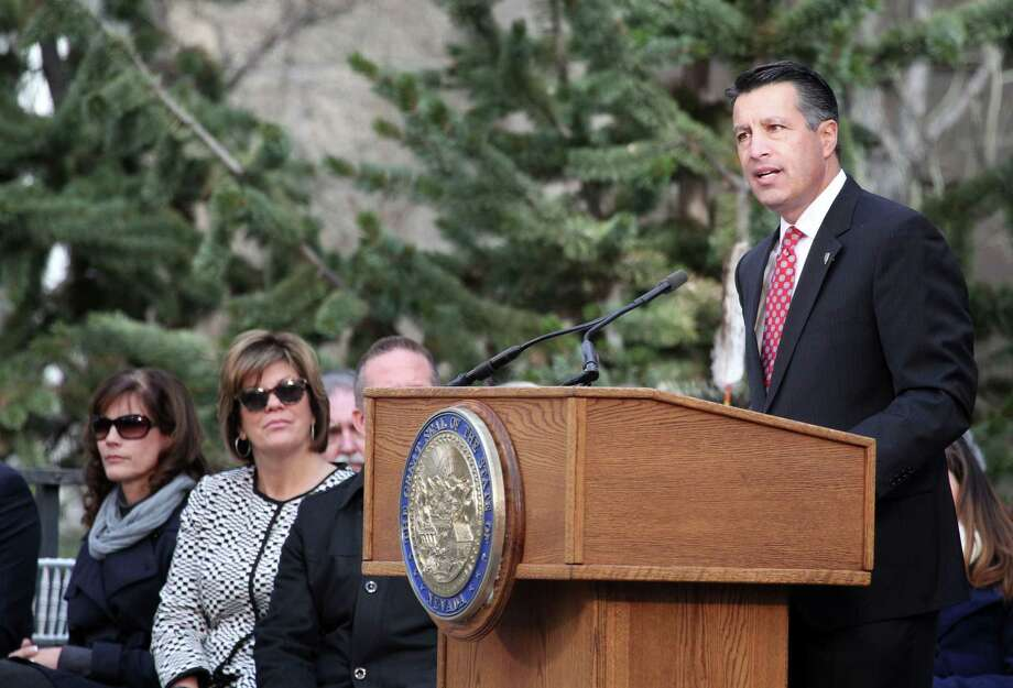 Nevada Gov. Brian Sandoval has signed legislation creating a universal  school-choice program that will allow parents to choose the best  education for their children. Photo: Lance Iversen / Associated Press / FR171256 AP