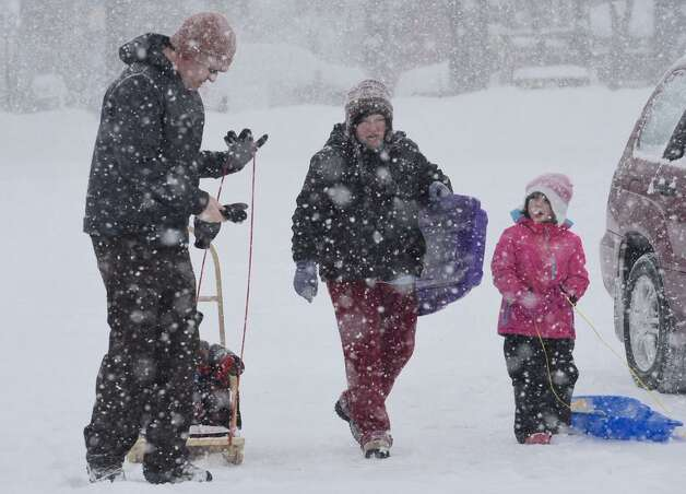 The Rousseau family of Delmar ties some sledding at Capital Hills in Albany on Monday, Feb. 2, 2015. (Skip Dickstein / Times Union)
