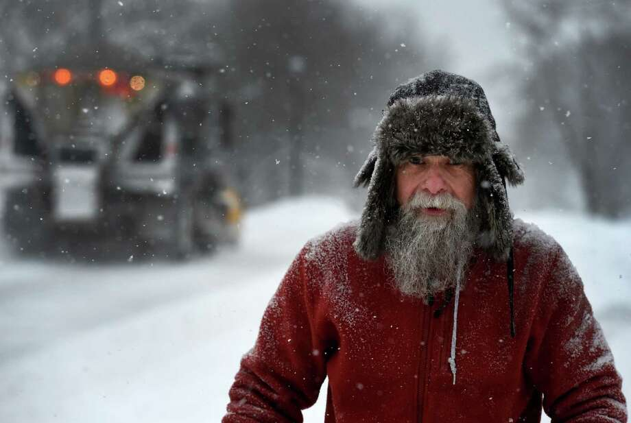 Peter O'Hearn is covered with snow while using his snow blower on Main Avenue Feb. 2, 2015 in Albany, N.Y.         (Skip Dickstein/Times Union) Photo: SKIP DICKSTEIN