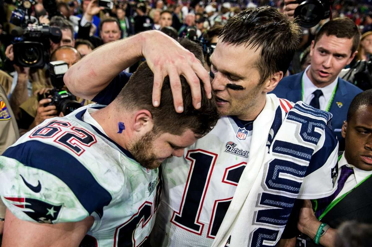 New England Patriots quarterback Tom Brady, right, shares an emotional moment with teammate Ryan Wendell, left, after they beat the Seattle Seahawks 28-24 in Super Bowl XLIX Sunday, February 1, 2015, at University of Phoenix Stadium in Glendale, Arizona. (Jordan Stead, seattlepi.com)