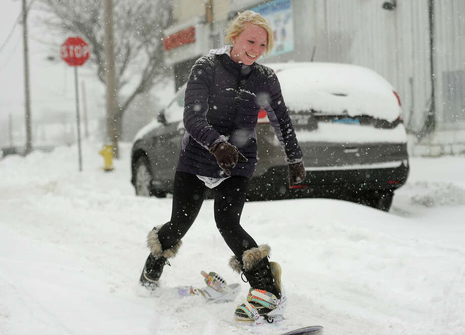 University of Bridgeport student Cailyn Klarich rides her snowboard down Wilson Street in The Black Rock section of Bridgeport, Conn. on Monday, February 2, 2015. Photo: Brian A. Pounds / Connecticut Post