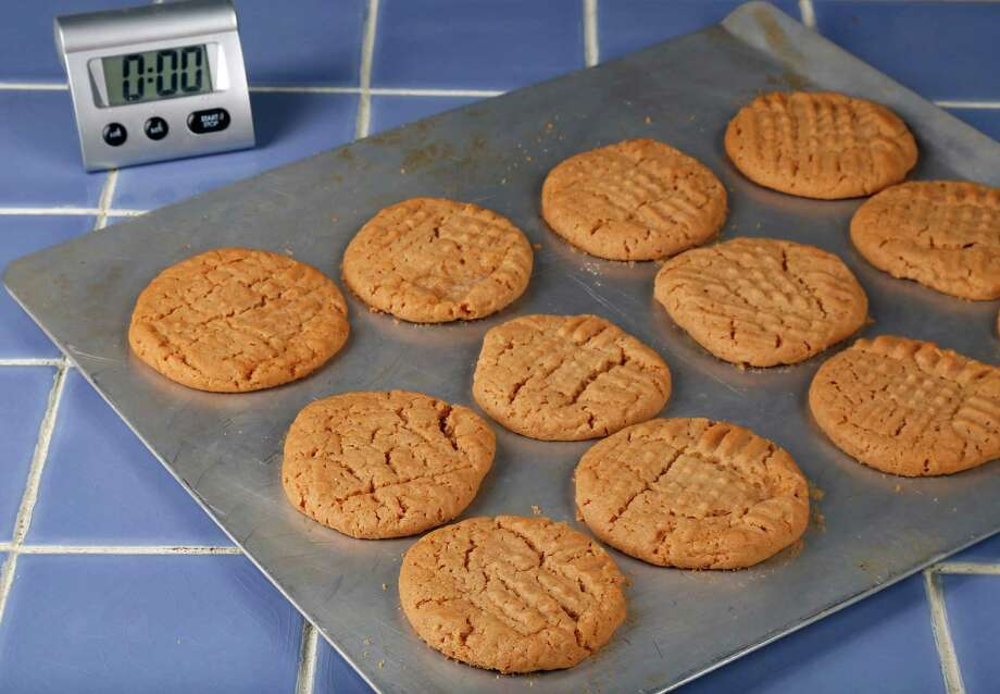 Mom's Honey Peanut Butter Cookies are a tasty twist on the original.Find the recipe here. Photo: James Nielsen, Staff / © 2015  Houston Chronicle
