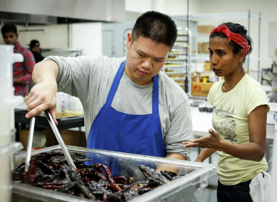 Azalina Eusope talks to her assistant, David Lu, at her commissary in S.F. Photo: Russell Yip / The Chronicle / ONLINE_YES