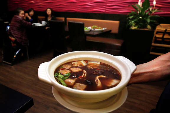 At Chilli Padi, a Chinese-Malaysian restaurant in in Oakland's Chinatown, the bak kut teh — an herbal broth soup, above — is a standout