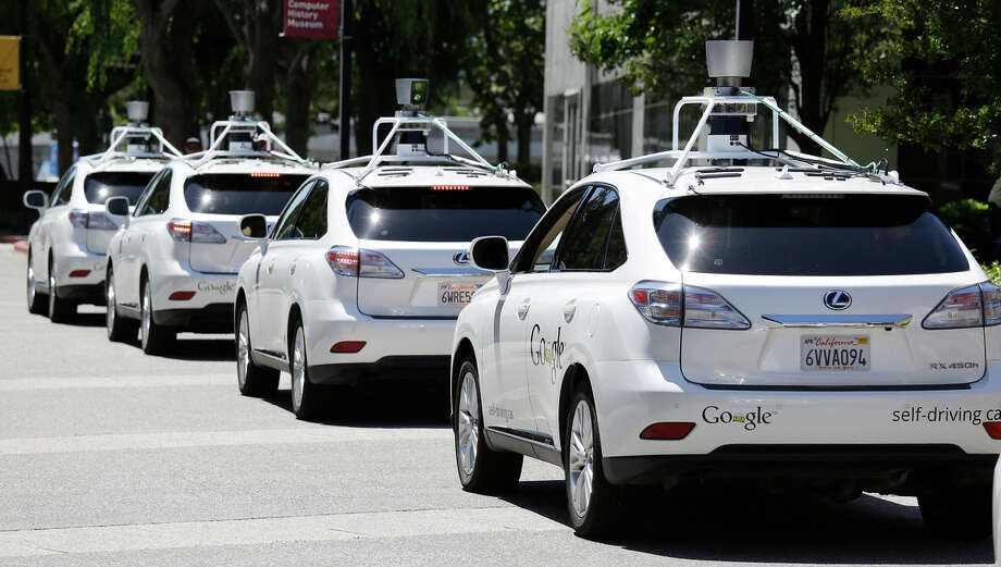 A row of Google self-driving cars line up outside the Computer History Museum in Mountain View. Some drivers like the technology. Photo: Eric Risberg / Associated Press / AP