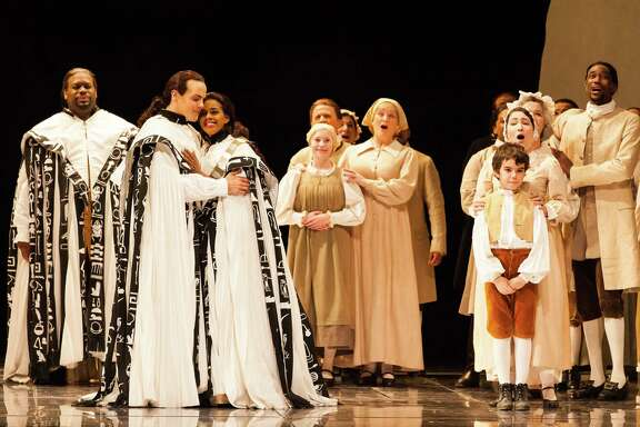 "David Portillo and Nicole Heaston are Tamino and Pamina, with Morris Robinson, left, as Sarastro, in ""The Magic Flute."""